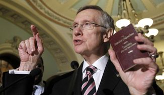 Senate Majority Leader Sen. Harry Reid of Nev., holds a copy of the Constitution and Declaration of Independence during a news conference on Capitol Hill in Washington Thursday, Dec. 16, 2010. (AP Photo/Alex Brandon)
