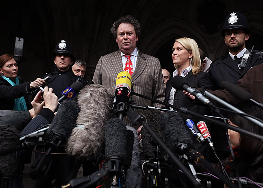 Mark Stephens, lawyer for WikiLeaks founder Julian Assange, center, delivers a statement to the media outside the High Court in London, Thursday, Dec. 16, 2010. Mr. Assange will be freed on bail and sent to stay at a British country mansion, a  judge ruled Thursday, rejecting prosecutors' attempts to keep him in prison as he fights extradition to Sweden. (AP Photo/Peter Macdiarmid, pool)