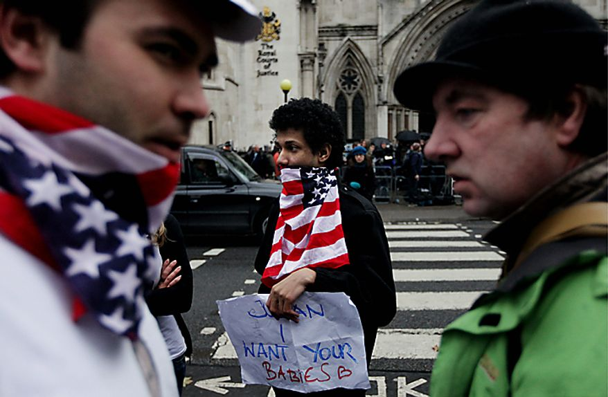 Supporters of WikiLeaks founder Julian Assange wait outside the High Court in London where a judge rejected Sweden's appeal against bail for Mr. Assange. (AP Photo/Matt Dunham)