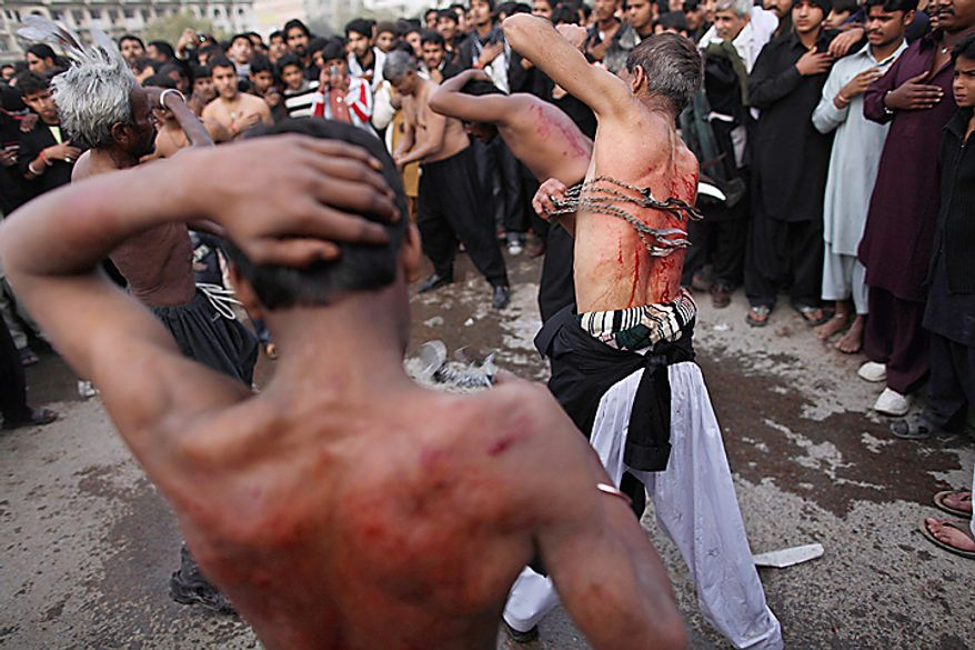 Shi'ite men flagelate themselves with knives during a Muharram procession in Islamabad, Pakistan, Thursday, Dec. 16, 2010. Muharram is a ten-day mourning period observed by Shi'ites around the world in remembrance of the martyrdom of Imam Hussein, the grandson of Prophet Muhammad. (AP Photo/Muhammed Muheisen)