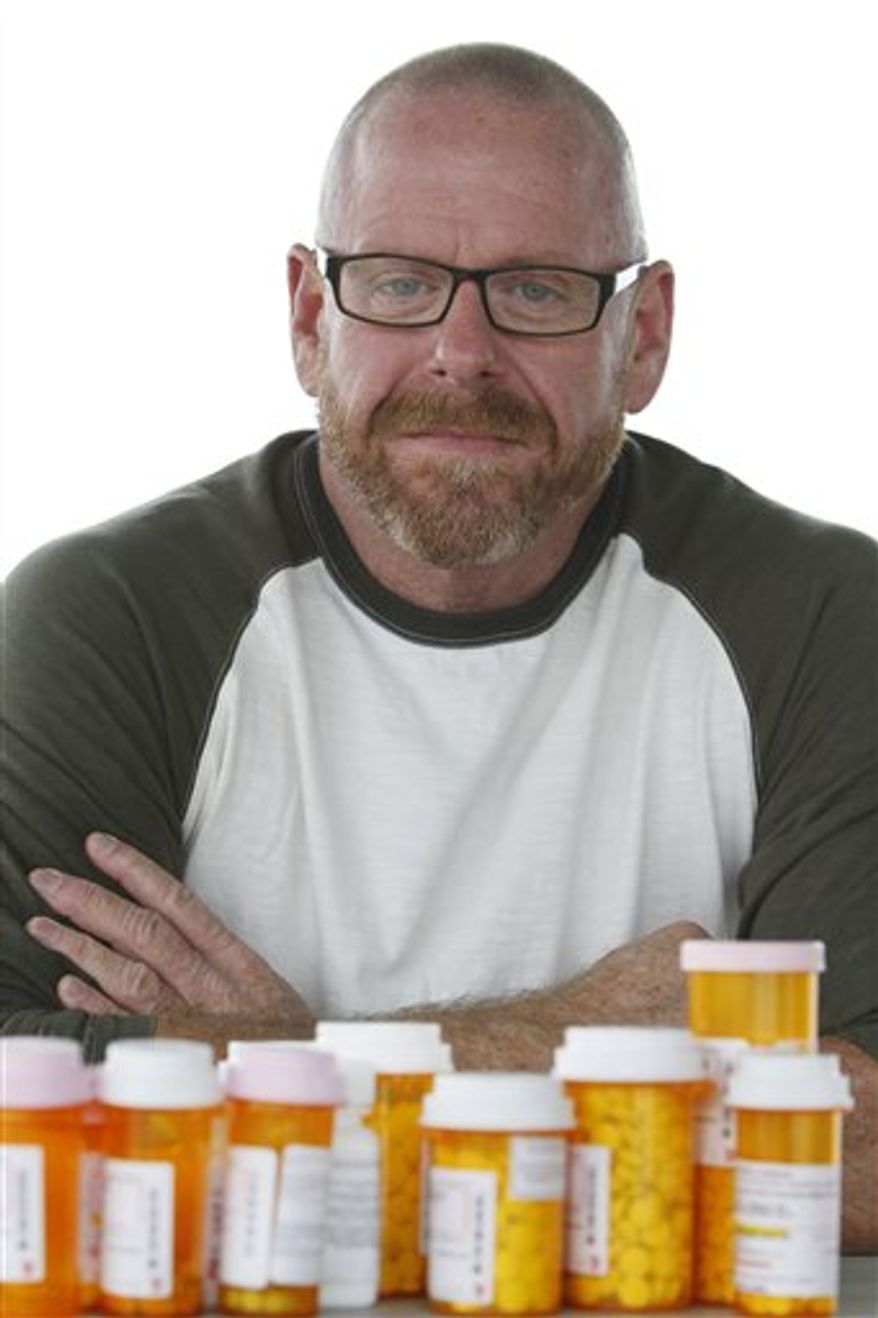In this Dec. 9, 2010 photo, Stephen Farrar shows some of the medications he must take on a daily basis, in Fort Lauderdale, Fla. Across the country, thousands of HIV-positive people who once would have qualified for state-administered programs that provide free AIDS drugs to low-income people, have been placed on waiting lists or removed from the rolls, as the dismal economy has driven up the need for the program just as states are grappling with budget crises and as people are living longer with HIV. (AP Photo/Wilfredo Lee)