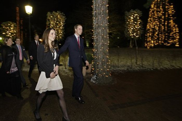Britain's Prince William and his fiancee Kate Middleton arrive to view the Thursford Christmas Spectacular gala in Thursford, England, Saturday, Dec. 18, 2010.  The royal couple, who are due to marry on April 29, 2011, met young cancer patients and visited the unique fund-raising gala Saturday, which showcases a cast of over 130 professional singers, dancers and musicians.  (AP Photo/Matt Dunham)