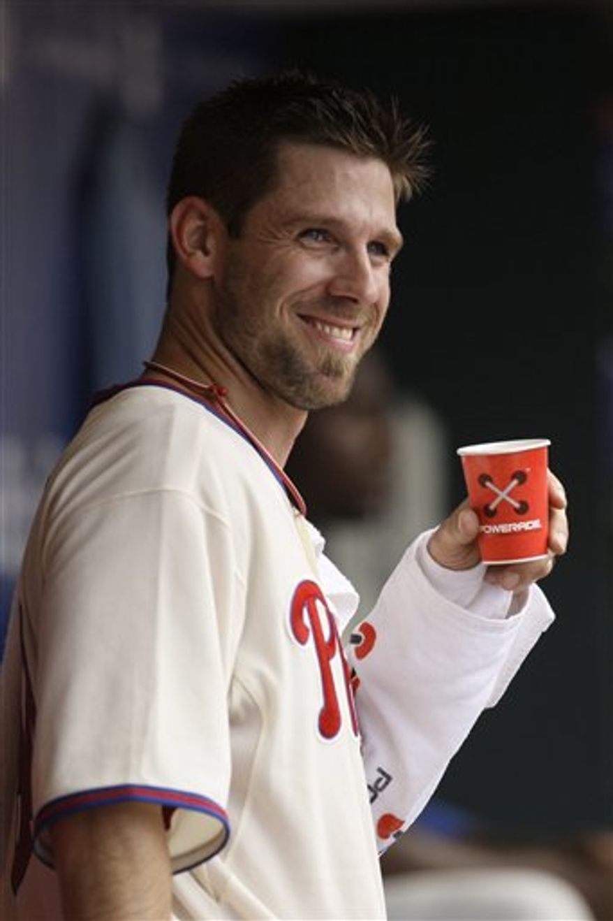 FILE - This Aug. 6, 2009, file photo shows Philadelphia Phillies' Cliff Lee smiling from the dugout after pitching in the sixth inning of a baseball game against the Colorado Rockies, in Philadelphia. The free-agent pitcher passed up an extra $50 million from the New York Yankees and reached a preliminary agreement on a $100 million, five-year contract with the Phillies on Monday night, Dec. 13, 2010, a person familiar with the deal told The Associated Press. (AP Photo/Matt Slocum, File)
