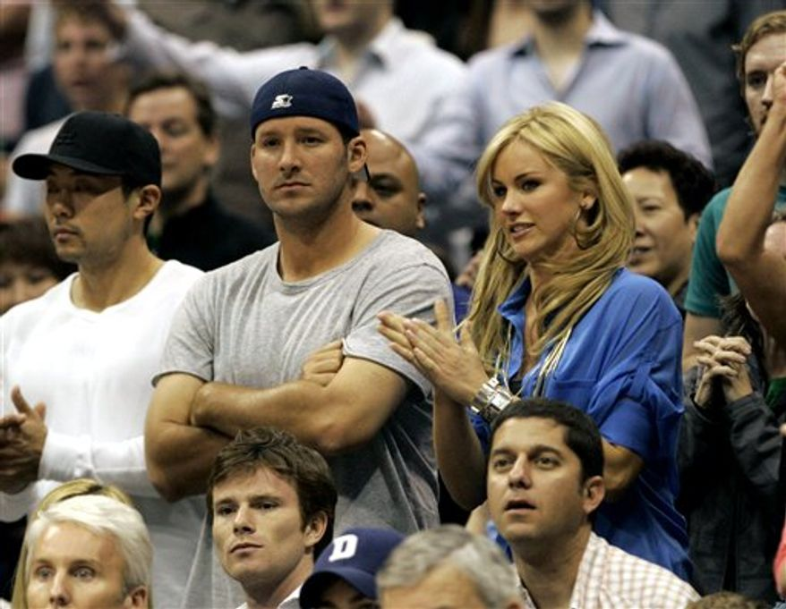 FILE - Dallas Cowboys quarterback Tony Romo, left, sits with Candice Crawford during the second half of an NBA basketball game of the Dallas Mavericks and the Oklahoma City Thunder in Dallas on in this April 3, 2010 file photo. Romo is engaged to be married to former Miss Missouri Candice Crawford. Crawford works as a sports reporter for KDAF-TV in Dallas. The station reports that the 30-year-old player proposed to Crawford while the couple were celebrating her 24th birthday at a Dallas restaurant on Thursday Dec. 16, 2010. (AP Photo/Mike Fuentes, File)