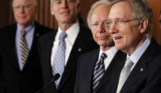 """Senate Majority Leader Sen. Harry Reid, Nevada Democrat, from right, speaks as he stands with Sen. Joe Lieberman, Connecticut Independent, Sen. Mark Udall, Colorado Democrat, and Sen. Patrick J. Leahy, Vermont Democrat, at a press conference about the """"Don't Ask Don't Tell"""" bill during an unusual Saturday session on Capitol Hill in Washington Saturday, Dec. 18, 2010.(AP Photo/Alex Brandon)"""