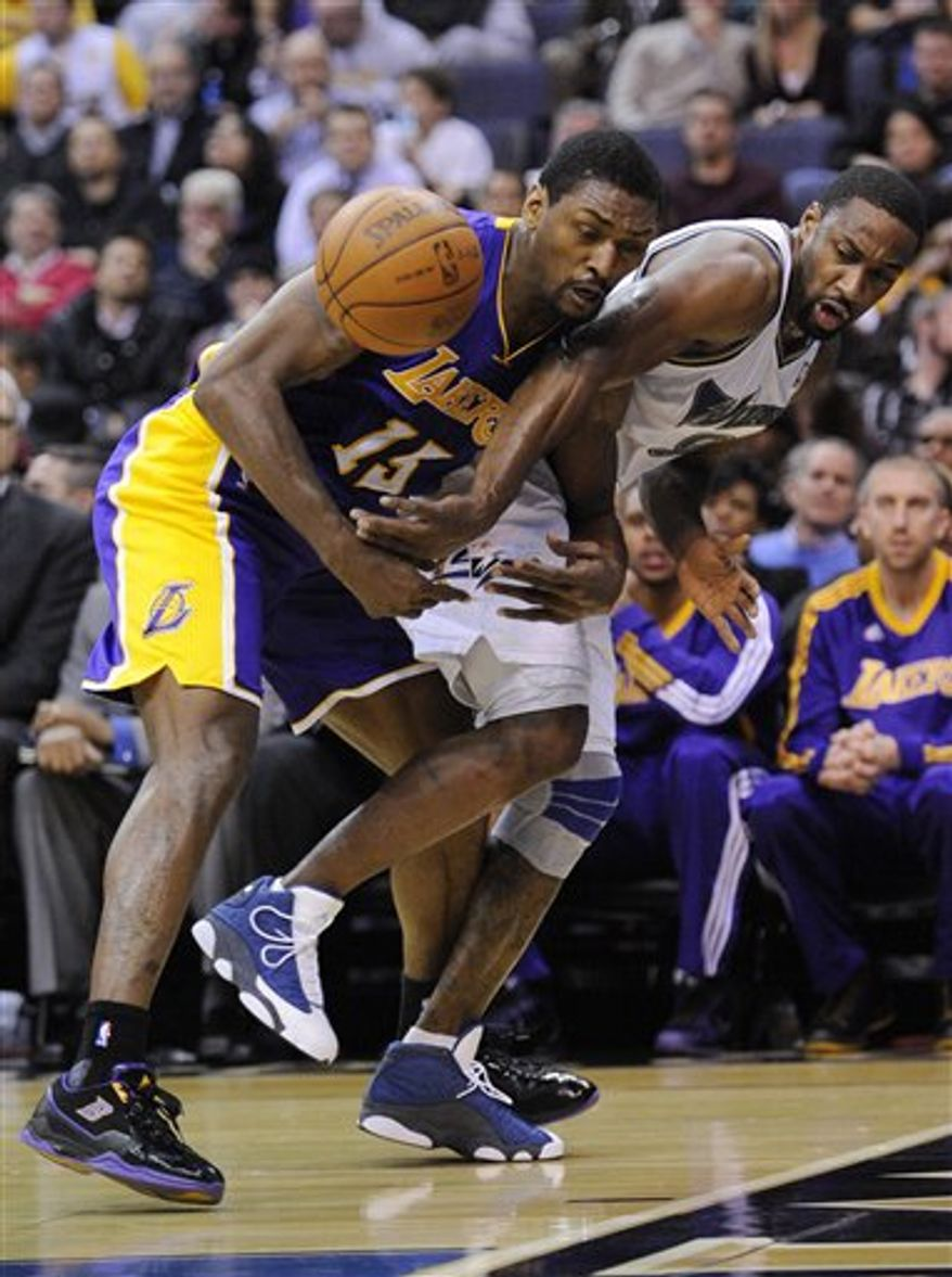 Washington Wizards point guard Gilbert Arenas, right, battles for the ball against Los Angeles Lakers small forward Ron Artest, left, during the first half of an NBA basketball game, Tuesday, Dec. 14, 2010, in Washington. (AP Photo/Nick Wass)