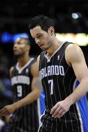 Orlando Magic guard J.J. Redick hangs his head as he leaves the court following the team's 111-94 loss to the Denver Nuggets during an NBA basketball game Tuesday, Dec. 14, 2010, in Denver. Redick scored 29 points against the Denver Nuggets. (AP Photo/Jack Dempsey)