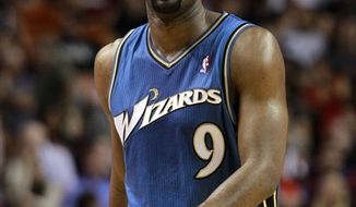 FILE - This Nov. 29, 2010, file photo shows Washington Wizards' Gilbert Arenas during an NBA basketball game against the Miami Heat,  in Miami. A person familiar with the situation says the Orlando Magic have traded for Arenas, and Hedo Turkoglu and Jason Richardson of the Phoenix Suns. Orlando will send forward Rashard Lewis to Washington and guards Vince Carter and Mickael Pietrus to Phoenix, the person told The Associated Press on condition of anonymity because the deals were still being finalized. (AP Photo/Alan Diaz, File)