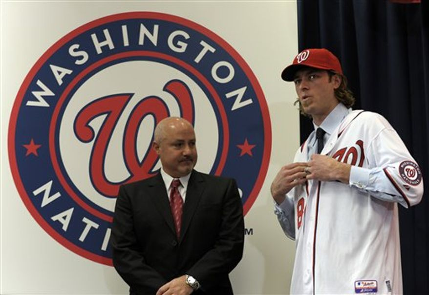 Washington Nationals newest outfielder Jason Werth, right,  speaks to Nationals General Manager Mike Rizzo during a news conference at Nationals Park in Washington, Wednesday, Dec. 15, 2010. (AP Photo/Susan Walsh)