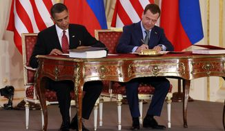 ** FILE ** President Obama (left) and Russian President Dmitry Medvedev sign the New START nuclear pact at the Prague Castle in Prague on April 8, 2010. (AP Photo/Alex Brandon, File)