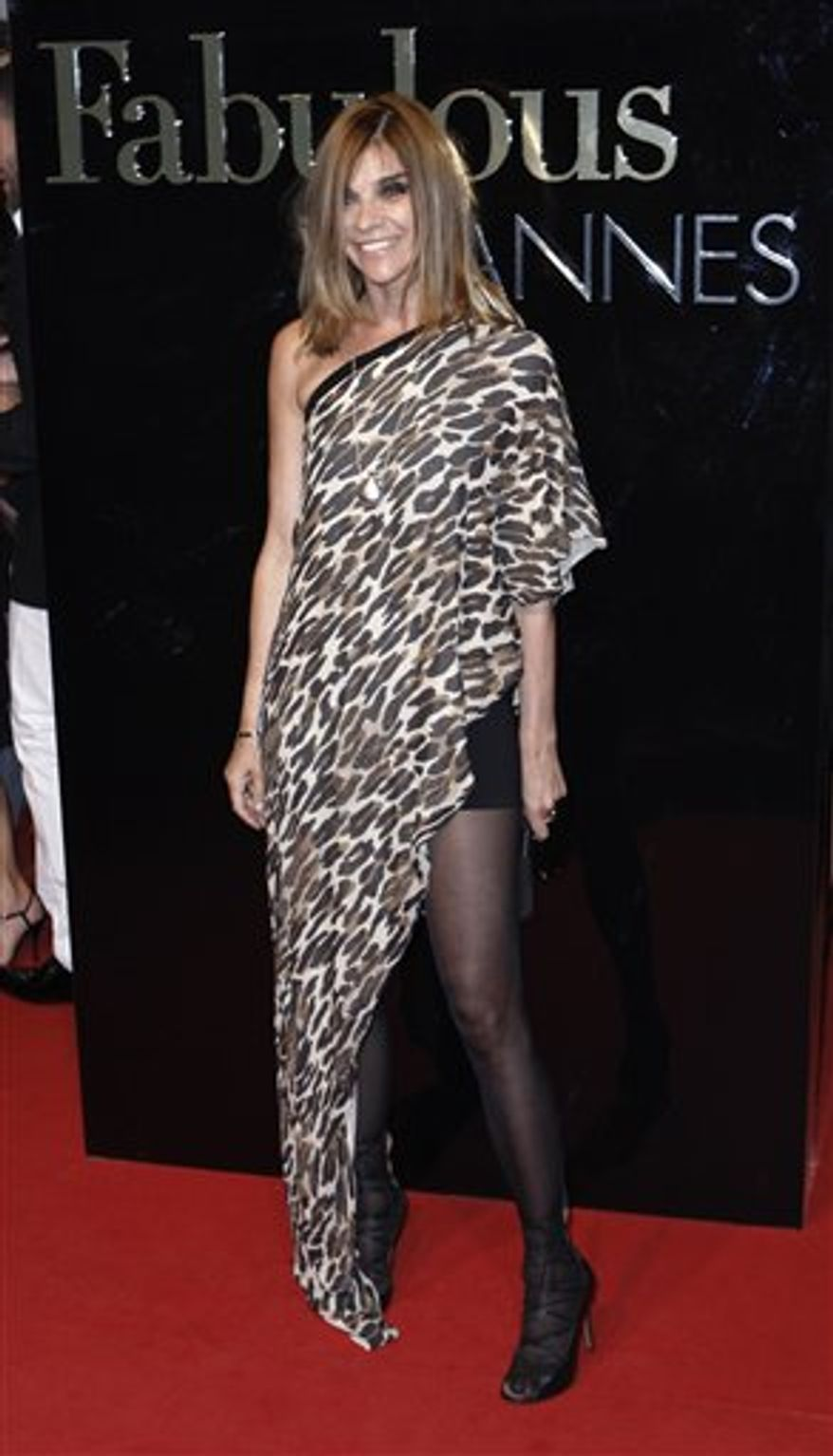 """In this Saturday, May 23, 2009 photo, Carine Roitfeld arrives for the Dolce & Gabbana party, during the 62nd International film festival in Cannes, southern France. Paris Vogue says its editor-in-chief, Carine Roitfeld, has decided to leave after a 10-year tenure in which the French fashion monthly became """"a worldwide reference and indispensable magazine."""" (AP Photo/Matt Sayles)"""