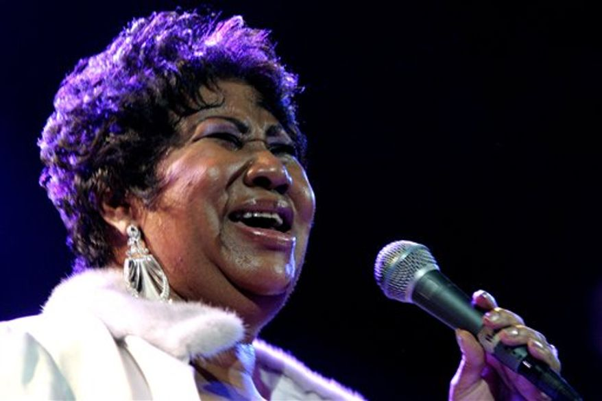 "FILE - In this Feb. 11, 2011 file photo, Aretha Franklin smiles after the Detroit Pistons-Miami Heat NBA basketball game in Auburn Hills, Mich. Franklin, who says she's back at ""150 percent,"" is planning to return to the stage in May for her first post-surgery performance. (AP Photo/Paul Sancya)"