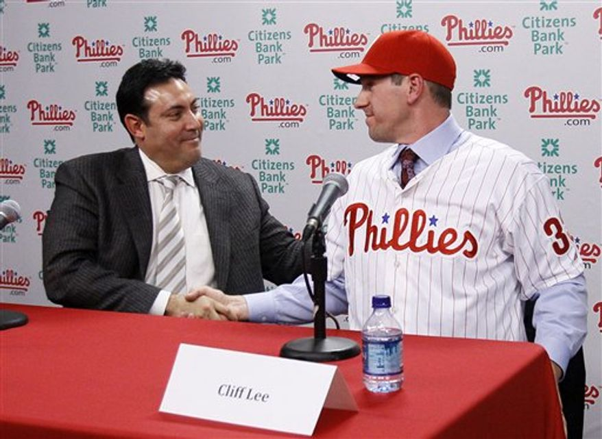 Philadelphia Phillies pitcher Cliff Lee poses for photographers after a baseball news conference, Wednesday, Dec. 15, 2010, in Philadelphia. Lee and the Phillies finalized a $120 million, five-year contract that brings the star pitcher back to Philadelphia. (AP Photo)
