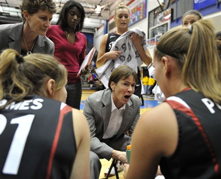 Stanford head coach Tara VanDerveer center, talks to her team during a timeout against DePaul during the first half of an NCAA college basketball game, Thursday, Dec. 16, 2010, in Chicago. (AP Photo/Jim Prisching)
