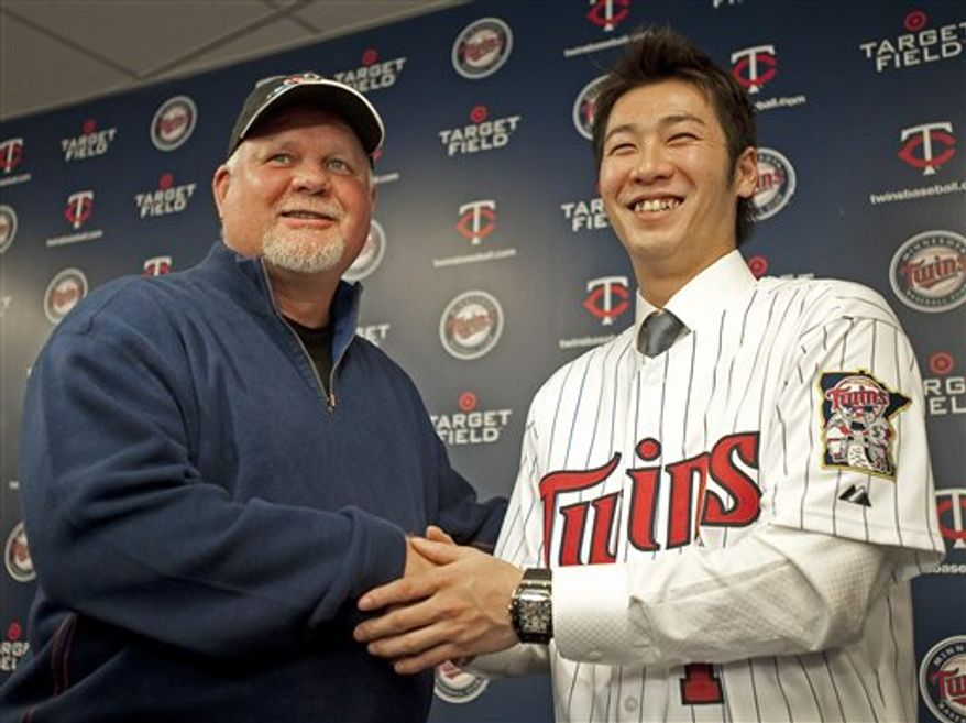 Tsuyoshi Nishioka, who signed a three-year, $9.25-million contract with the Minnesota Twins, answers questions during a news conference in Minneapolis on Saturday, Dec. 18, 2010. Nishioka, 26, batted .346  for the Chiba Lotte Marines in Japan last season. (AP Photo/Craig Lassig)