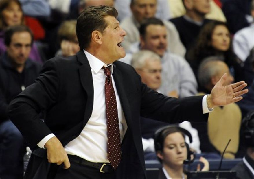 In this photo taken Thursday, Dec. 9, 2010, Connecticut coach Geno Auriemma speaks to an offficial during an NCAA women's college basketball game at Storrs, Conn. UConn defeated Marquette 79-47 to win their 87th straight game. (AP Photo/Bob Child)