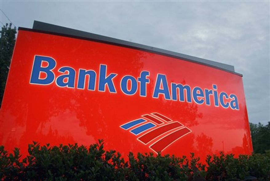 FILE - In this April 21, 2008 file photo, a sign for a Bank of America branch is shown in Charlotte, N.C. Bank of America says it will no longer process transactions for the website WikiLeaks, following similar actions by several other financial institutions. (AP Photo/Chuck Burton, File)