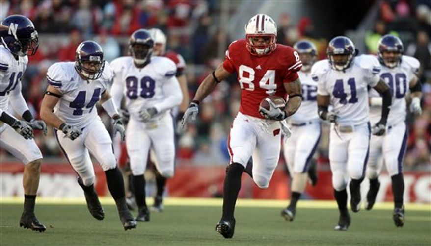 FILE - In this file photo taken Nov. 27, 2010, Wisconsin tight end Lance Kendricks (84) breaks away for a 30-yard reception during the first half of an NCAA college football game against Northwestern in Madison, Wis. No. 4 Wisconsin (11-1) is finally in the Rose Bowl again, facing undefeated No. 3 TCU (12-0). Kendricks, now a senior tight end, recognized he had developed all the skills it took to be successful in Wisconsin's offense in the Badgers' bowl game last year. The Rose Bowl is Jan. 1, 2011. (AP Photo/Morry Gash, File)