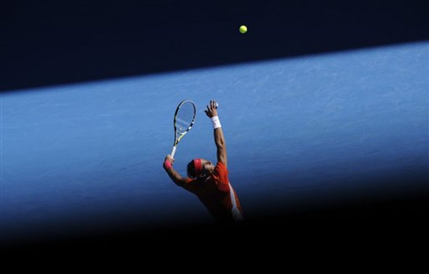 FILE -In this Jan. 24, 2010 file photo, Rafael Nadal of Spain serves to Ivo Karlovic of Croatia during their Men's singles fourth round match  at the Australian Open tennis championship in Melbourne, Australia.   (AP Photo/Andrew Brownbill, File)