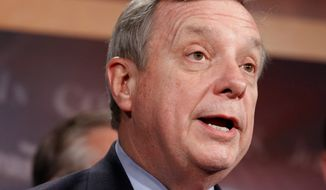 """Associated Press """"[Congress' repeal of 'don't ask, don't tell'] shows me that America has come to a point where it understands that sexual orientation should not be used against you,"""" said Sen. Richard J. Durbin, Illinois Democrat."""