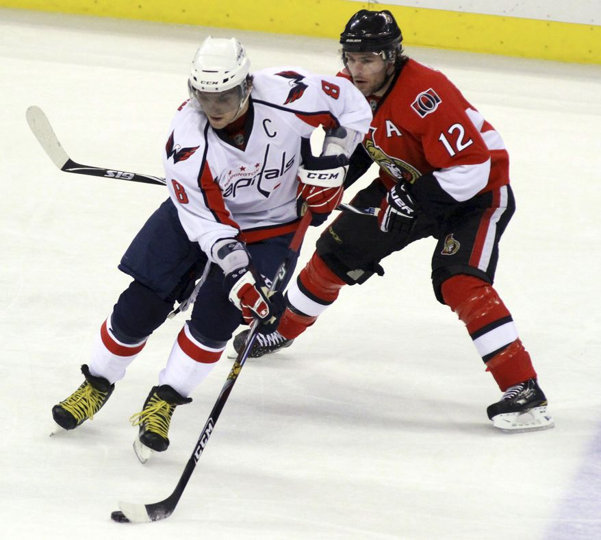 ** FILE ** Washington Capitals' Alex Ovechkin (8) works the puck against Ottawa Senators' Mike Fisher (12) during the second period of an NHL hockey game in Ottawa on Sunday, Dec. 19, 2010. (AP Photo/The Canadian Press, Fred Chartrand)
