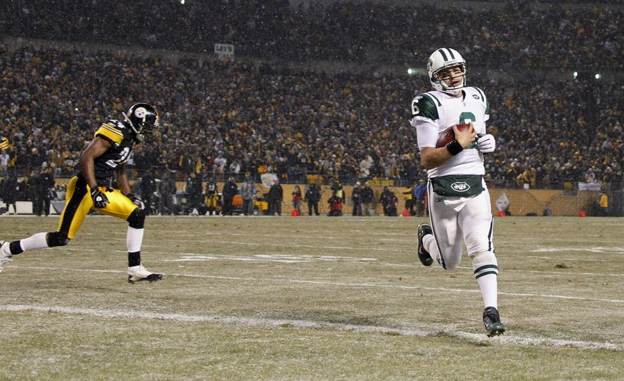 New York Jets quarterback Mark Sanchez (6) crosses the goal line on a bootleg run for a touchdown in the third quarter of an NFL football game Sunday, Dec. 19, 2010, in Pittsburgh. Pittsburgh Steelers cornerback Ike Taylor is at left. The Jets won 22-17. (AP Photo/Keith Srakocic)