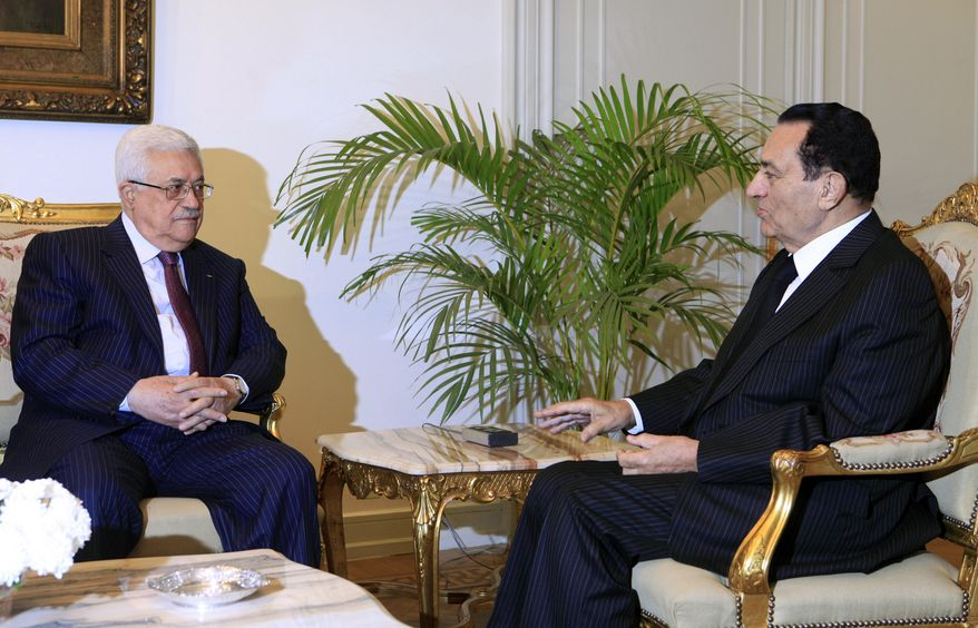 ** FILE ** Egyptian President Hosni Mubarak (right) meets with Palestinian Authority President Mahmoud Abbas at the presidential palace in Cairo on Thursday, Dec. 9, 2010. The talks came within the framework of efforts to revive the Middle East peace process. (AP Photo/Amr Nabil)