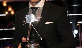 Britain's soccer player David Beckham wins the Lifetime Achievement award 2010 during the BBC Sport Personality of the Year Awards at the LG Arena, Birmingham, England, Sunday Dec. 19, 2010. (AP Photo/PA, David Davies) UNITED KINGDOM OUT NO SALES NO ARCHIVE