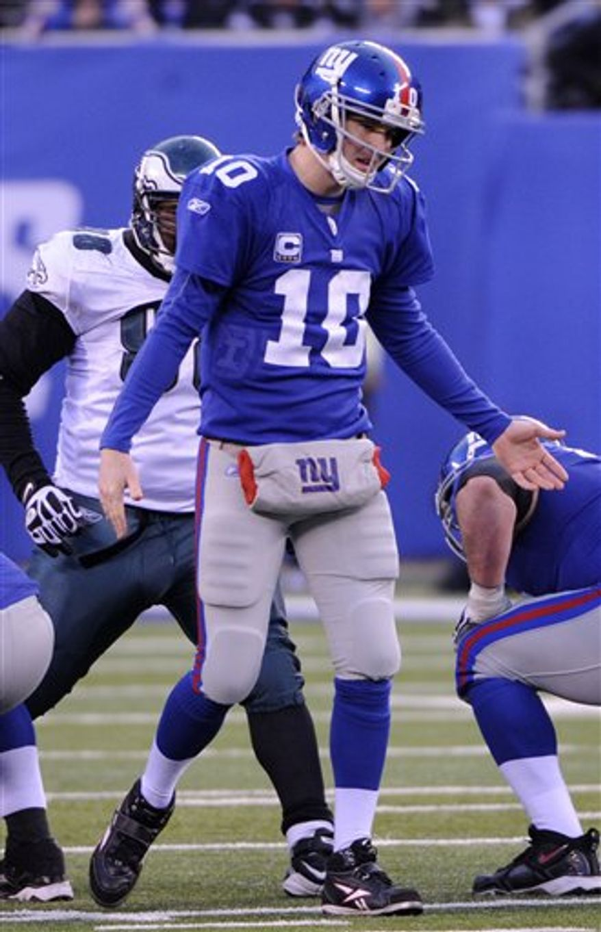 New York Giants quarterback Eli Manning reacts during the fourth quarter of an NFL football game against the Philadelphia Eagles at New Meadowlands Stadium, Sunday, Dec. 19, 2010, in East Rutherford, N.J. The Eagles won 38-31. (AP Photo/Bill Kostroun)