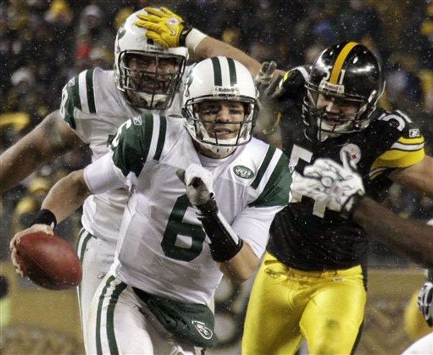 New York Jets quarterback Mark Sanchez, left, scrambles during the first quarter of an NFL football game against the Pittsburgh Steelers in Pittsburgh, Sunday, Dec. 19, 2010. In pursuit is Steelers linebacker James Farrior (51). (AP Photo/Gene J. Puskar)