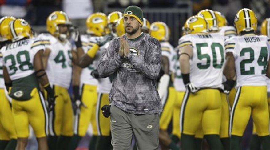 Green Bay Packers head coach Mike McCarthy and quarterback Matt Flynn (10) talk during a first quarter timeout of their NFL football game against the New England Patriots in Foxborough, Mass., Sunday night, Dec. 19, 2010. (AP Photo/Stephan Savoia)