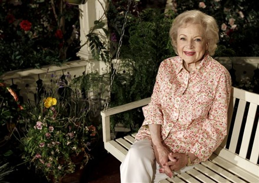 """In this film publicity image released by Touchstone Pictures, sandra Bullock, left, and Betty White are shown in a scene from, """"The Proposal."""" White has been voted the Entertainer of the Year by members of The Associated Press.  (AP Photo/Disney/Touchstone Pictures, Kerry Hayes)"""