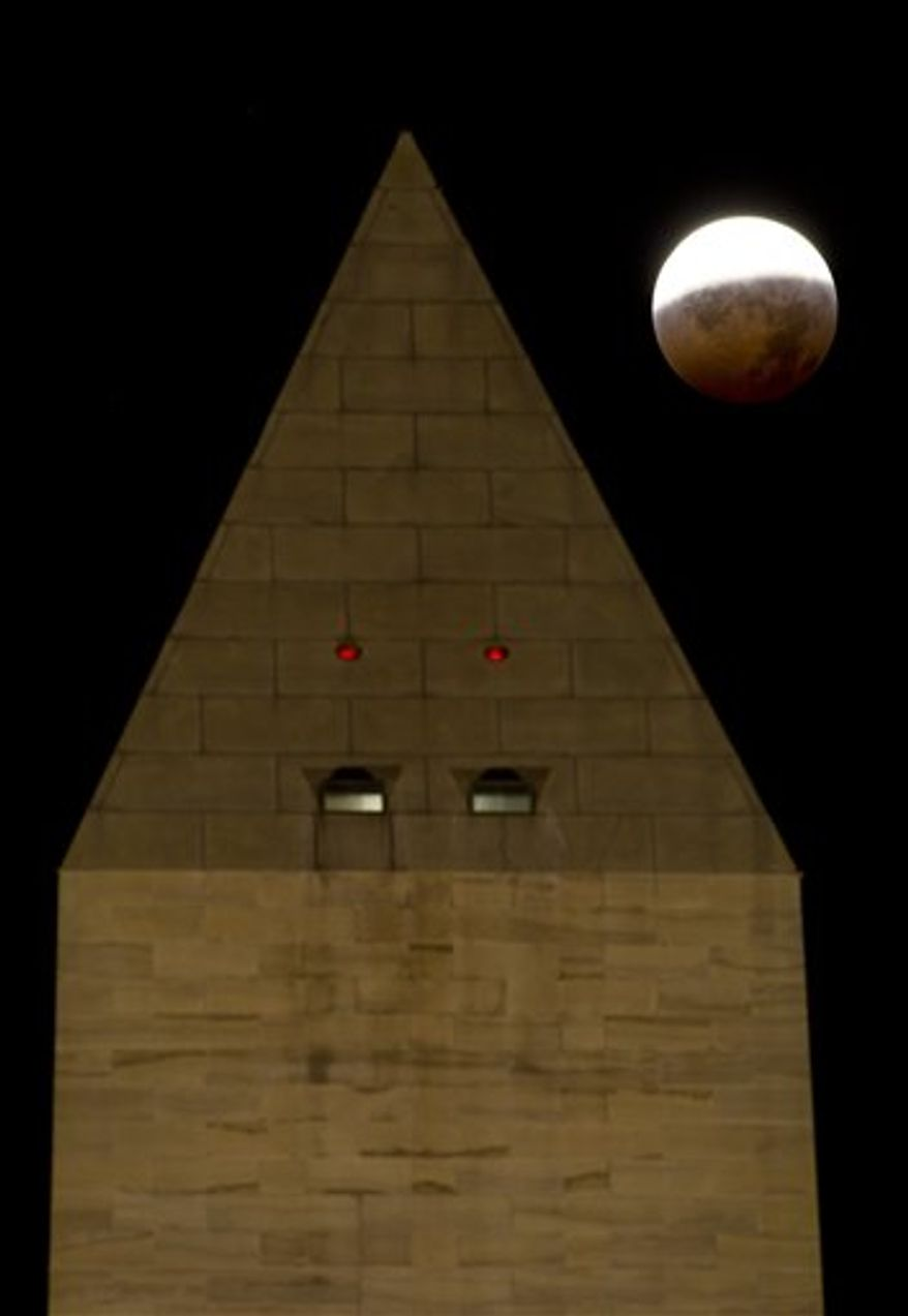 In a photo provided by NASA the Washington Monument is seen as the full moon is shadowed by the Earth during a total lunar eclipse on the arrival of the winter solstice, Tuesday, December 21, 2010 in Washington.  From beginning to end, the eclipse lasted about three hours and twenty-eight minutes.  (AP Photo/NASA/Bill Ingalls)