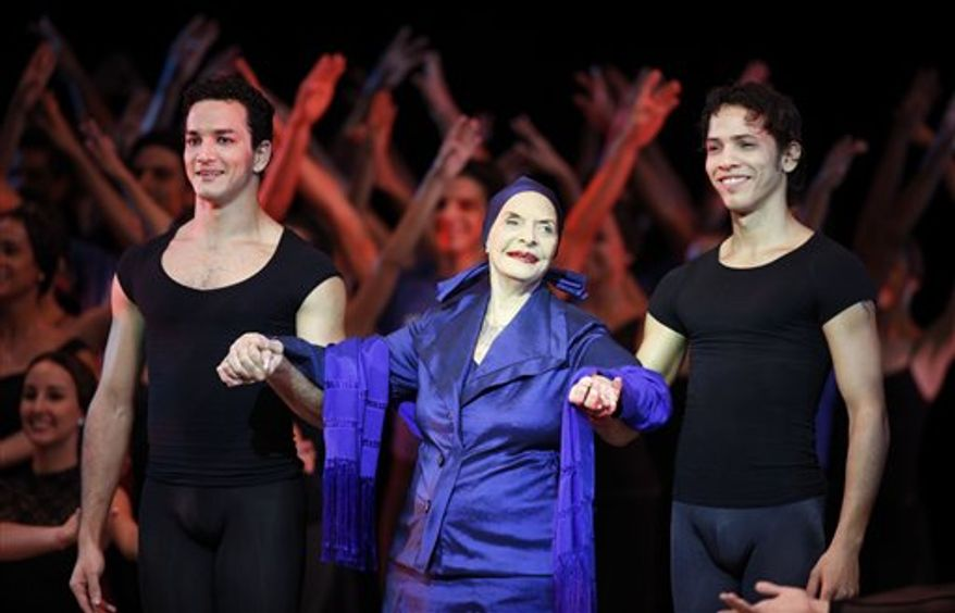 FILE - In this Oct. 28, 2010 file photo, Alicia Alonso, center, is escorted by dancers during the opening ceremony of the 22nd International Ballet Festival in Havana, Cuba, Thursday, Oct. 28, 2010. Alonso, considered a living legend of international ballet and a national treasure in her native Cuba, was honored with a ballet and music-filled gala on the eve of her 90th birthday in Havana on Dec. 20th.   (AP Photo/Javier Galeano, File)