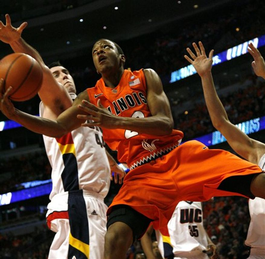 Illinois' Demetri McCamey drives ahead of  llinois-Chicago's Paris Carter during the first half of an NCAA college basketball game  in Chicago, Ill. on Saturday Dec. 18, 2010. (AP Photo/Charles Cherney)