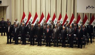 The new Iraqi government is pictured at a swearing-in ceremony in Baghdad on Tuesday, Dec. 21, 2010. Iraqi lawmakers unanimously approved the new government, which will be headed by incumbent Shi'ite Prime Minister Nouri al-Maliki (bottom right). The installation of the officials ends nine months of political deadlock that threatened to stall economic development and suck the country back into sectarian violence. (AP Photo/Karim Kadim)