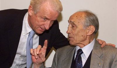 """FILE - In this Monday April 22, 2002 file photo Italian national team coach Giovanni Trapattoni, left, listens to former national team coach Enzo Bearzot at the """"The Golden Bench"""" (Panchina D'Oro) awards in Florence, central Italy, Monday April 22, 2002. Italy's 1982 World Cup-winning coach Enzo Bearzot died in Milan aged 83 on Tuesday, Dec. 21, 2010 (AP Photo/Fabrizio Giovannozzi)"""