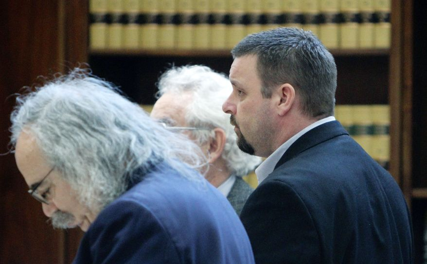 Joshua Turnidge (center) stands with his attorneys on Wednesday in Marion County Circuit Court in Salem, Ore. A jury has handed down death sentences for Bruce Turnidge and his son, Joshua.