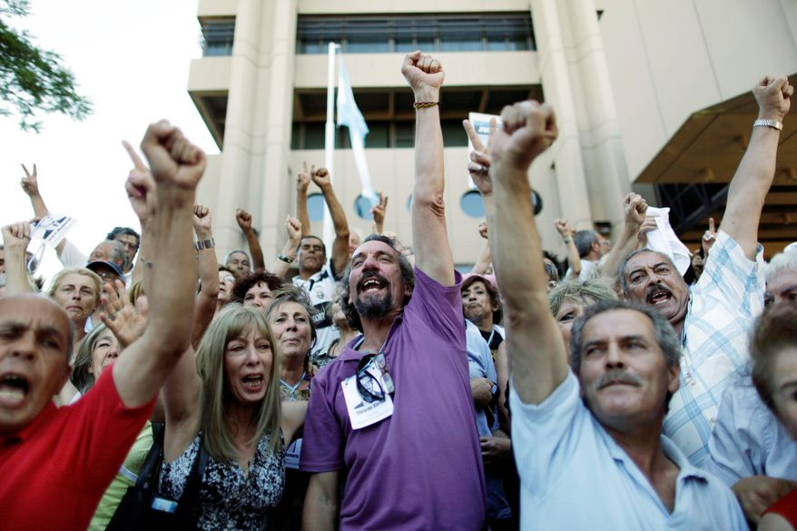 ASSOCIATED PRESS PHOTOGRAPHS Relatives of people killed during Argentina's dirty war rejoice Wednesday in Cordoba after former dictator Jorge Videla was sentenced to life in prison for the torture and murder of 31 prisoners in 1976.