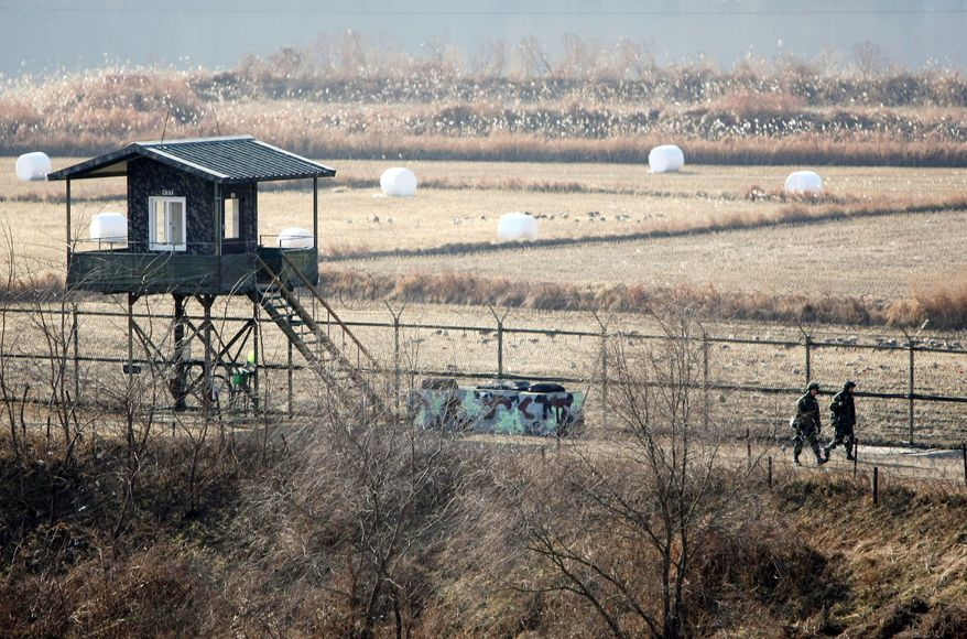South Korean border guards patrol the fence near the border village of Panmunjom on Wednesday as the South Korean air force and army prepare for massive drills.