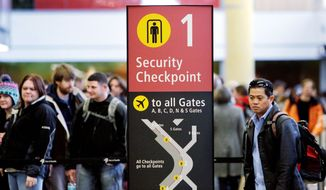 ** FILE ** Security lines grow at Seattle-Tacoma International Airport during the 2010 Christmas season. (Associated Press)