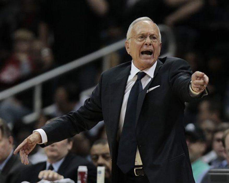 Charlotte Bobcats head coach Larry Brown yells to his players in the fourth quarter of an NBA basketball game against the Atlanta Hawks, Friday, Dec. 17, 2010, in Atlanta. Atlanta won 90-85. (AP Photo/John Bazemore)