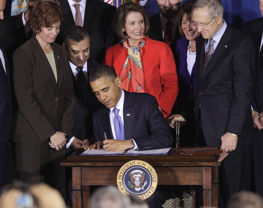 President Obama signs the Don't Ask, Don't Tell Repeal Act of 2010 on Wednesday, Dec. 22, 2010, during a ceremony at the Interior Department in Washington. House Speaker Nancy Pelosi (center), California Democrat, and Senate Majority Leader Harry Reid (right), Nevada Democrat, look on. (AP Photo/Pablo Martinez Monsivais)