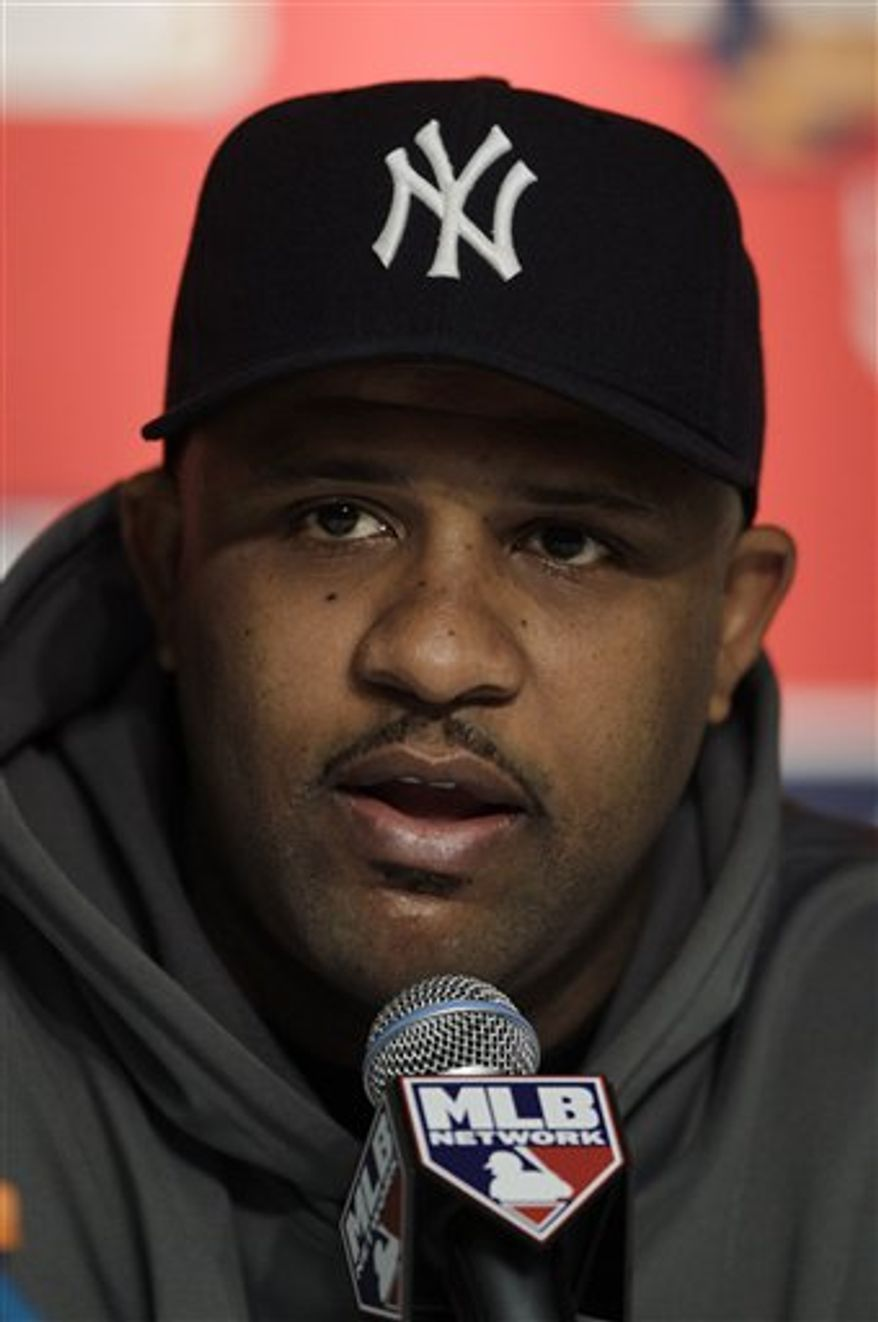 FILE - This Oct. 19, 2010, file photo shows New York Yankees starting pitcher CC Sabathia during his news conference before Game 4 of baseball's American League Championship Series against the Texas Rangers, in New York. Sabathia hoped to be pitching alongside close pal Cliff Lee again next year, reunited in Yankee pinstripes. (AP Photo/Charles Krupa, File)