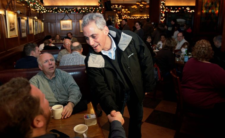 ASSOCIATED PRESS Rahm Emanuel, who spent two years as White House chief of staff, campaigns at the Berghoff Restaurant before a news conference Thursday. Polls show him leading the race to be mayor of Chicago.
