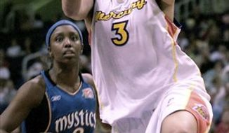 FILE - In this Sunday, July 2, 2006 file photo, Phoenix Mercury guard Diana Taurasi (3) drives to the hoop against Washington Mystics forward Tamara James (2) during the second half of their WNBA game in Phoenix. The lawyer for WNBA standout Diana Taurasi tells The Associated Press that the former UConn star has tested positive for a mild stimulant while playing in a pro basketball league overseas.  (AP Photo/Tom Hood, File)