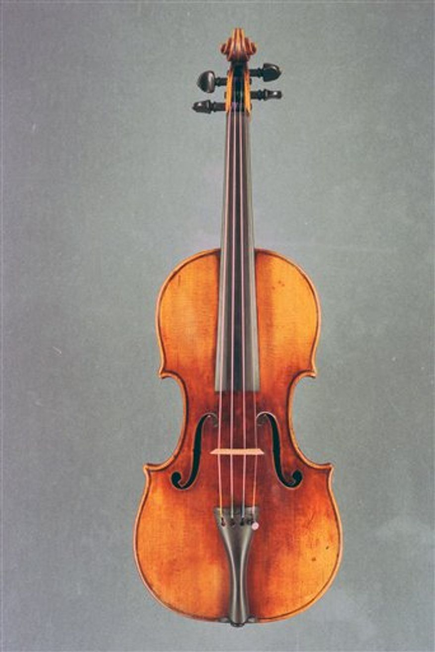 An undated image released by the British Transport Police on Thursday Dec. 23, 2010, of a 1697 Stradivarius violin. Three people were arrested for stealing a 1.2 million-pound ($1.85 million) antique violin from a musician while she stopped for a snack at a London sandwich bar, British police said Thursday. South Korean violinist Min-Jin Kym was eating inside the sandwich shop outside Euston station on Nov. 29 when she noticed that her black violin case _ whch contained the 300-year-old Stradivarius as well as two expensive bows _ was missing, police said. The violin, made in 1696, is one of only around 400 in the world. It was stolen along with a Peccatte bow, valued at 62,000 pounds, and another bow worth more than 5,000 pounds. (AP Photo/British Transport Police)