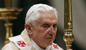 Pope Benedict XVI celebrates Christmas Mass in St. Peter's Basilica at the Vatican on Friday, Dec. 24, 2010. (AP Photo/Andrew Medichini)