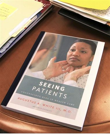 """In this Dec. 21, 2010 photo, a proof copy of the book, """"Seeing Patients,"""" rests on Harvard Medical School professor Augustus White's desk in Boston. White's memoir calls for more diversity in the medical field and an end to health care disparities. (AP Photo/Chitose Suzuki)"""