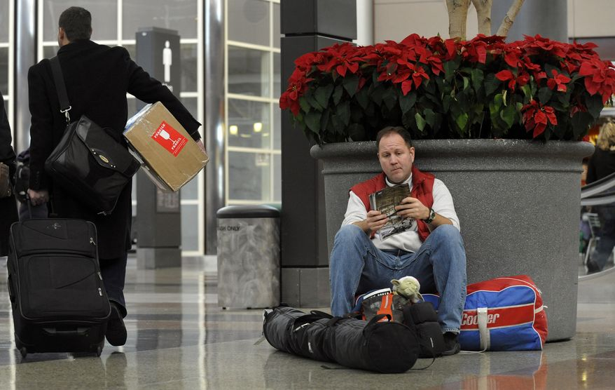 Hank Ritchie of San Francisco waits for his family to arrive at Denver International Airport in Denver on Friday, Dec. 24, 2010. (AP Photo/The Denver Post, Craig F. Walker)